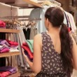 Woman putting away clothes — Stok video
