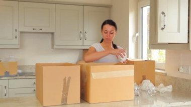 Woman packing up boxes and man moving them — Stock Video