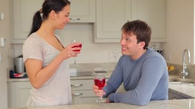 Couple drinking red wine with husband presenting gift — Stock Video