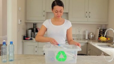 Woman putting plastic into recycling bin — Stock Video