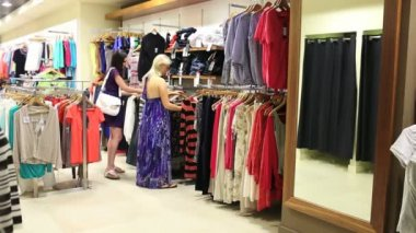 Woman picking up dress and looking in mirror — Stock Video