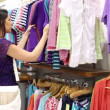 Stock Video: Woman looking through clothes