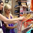 Stock Video: Women looking at shirts