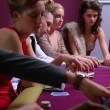 At poker table placing bets woman in red dress going all in — Stock Video #21348695