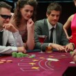Stock Video: Man in sunglasses winning at blackjack