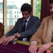 Being dealt poker cards with two folding and one placing bet — Stock Video