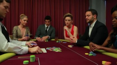 Dealer dealing poker cards and bets are being placed — Stock Video