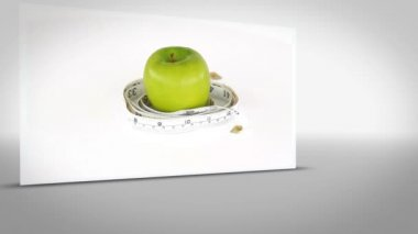 Clip of apple surrounded by measuring tape — Stock Video