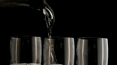 Three champagne flutes being filled — Stock Video
