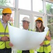 Architects discussing the construction - Stock Photo