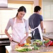 图库视频影像: Happy couple cooking together