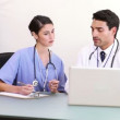 Stock Video: Doctors working with a laptop
