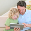 Father and son using a tablet computer — Stock Video