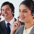 Smiling call centre agents working together — Stock Video