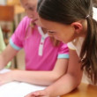 Pupil helping a classmate — Vídeo de stock