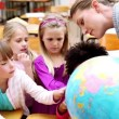 Pupils pointing at a globe — Stock Video