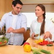 Husband and wife cooking together — Vídeo de stock