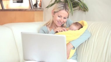 Woman holding a child is making a video call — Stock Video