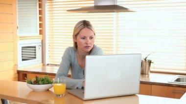 Woman drinks a glass of orange juice — Stock Video