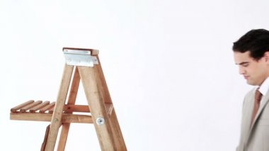 Smiling man getting up on a ladder — Stock Video
