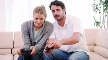 Young couple playing video games — Stock Video