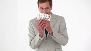 Businessman smelling bank notes — Stock Video