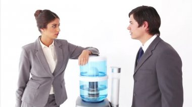 Colleagues chatting next to the water cooler — Stock Video