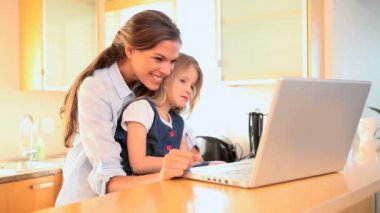 Mother and daughter watching a video on a laptop — Stock Video