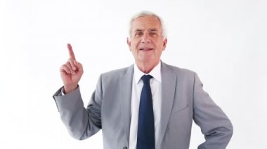 Smiling mature man pointing his finger up — Stock Video