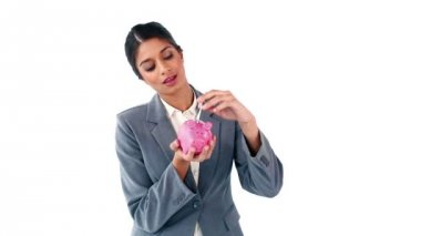 Smiling secretary holding a piggy bank — Stock Video