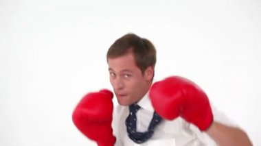 Businessman boxing with gloves — Stock Video
