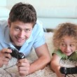 Father and son playing video game — Stock Video