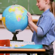 Girl looking at a Globe — Stock Video #21500949
