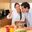 Talking couple in the kitchen tasting the food — Stock Video