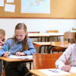 Stock Video: Serious pupils writing