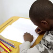 Stock Video: Pupil using coloring pens