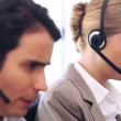 Call centre agent talking while using her headset — Stock Video
