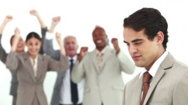 Man laughs while his colleagues are cheering — Stock Video