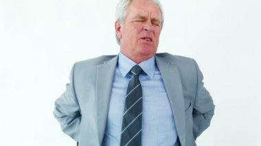Mature man having back troubles — Stock Video
