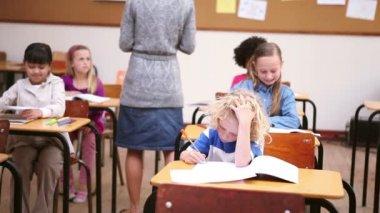 Peaceful teacher handing out sheets — Stock Video