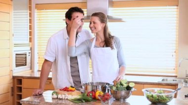 Husband tasting his wife's cooking with a spoon — Stock Video