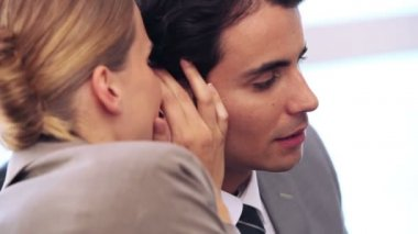Businesswoman telling a secret to her colleague — Stock Video