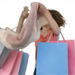 Woman with bags of shopping in her hands - Stock Photo