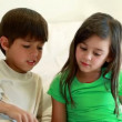 Siblings reading book together — Stock Video #21617241