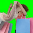 A woman with shopping trying on her scarf — Stock Video