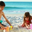 Stock Video: Siblings building sand castles
