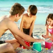 Happy family building sand castles — Stock Video