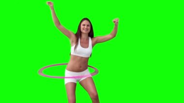 Woman happily spinning a hula hoop — Stock Video