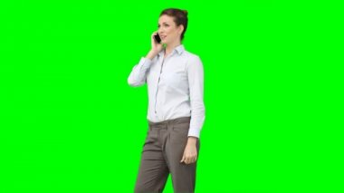 A business woman talks on her mobile phone — Stock Video