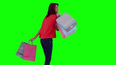 Woman swinging her shopping bags — Stock Video